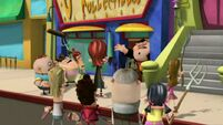 Oz throws the robot head into the mob