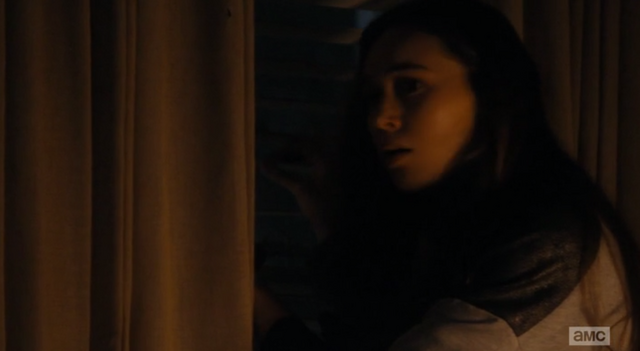 File:Alicia is looking out at the street through the blinds.png