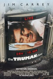"Film poster showing a large skyscraper located next to several smaller ones. On the side of the building is a large screen, showing a man laying his head on a pillow, eyes closed and smiling. Digital text above and below the screen state ""LIVE"" and ""DAY 10,909"", with the film's title right below it. Text at the top of the image includes the sole starring credit and text at the bottom includes the film's tagline and credits."