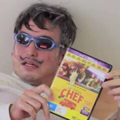 Frank holding his copy of the movie