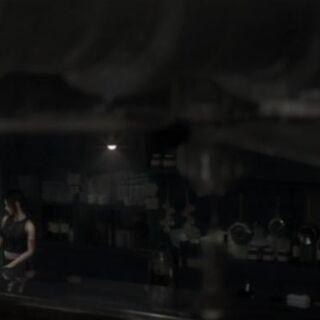 Tifa working behind the bar.