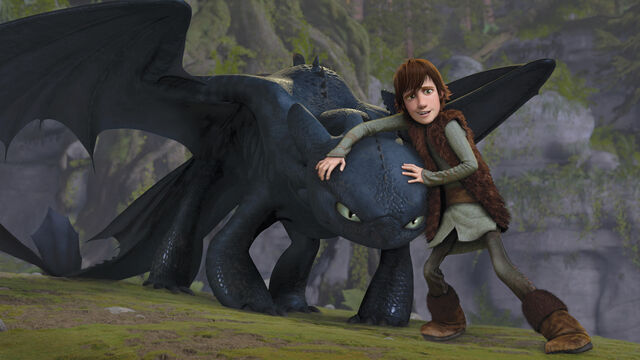 File:Hiccup keeping Toothless from attacking.jpg