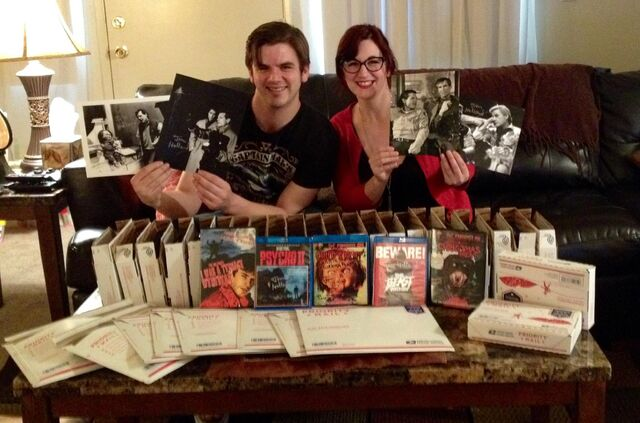 File:TnT Presents team Chris and Carrie with Merchandise.jpg