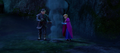 Kristoff helps keep Anna warm.png