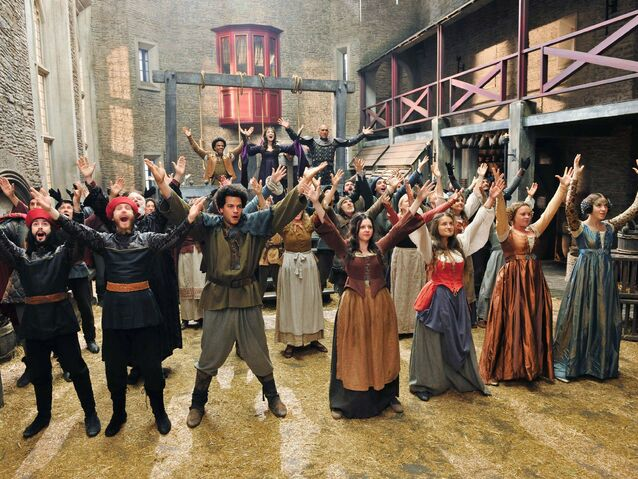 File:Galavant A New Season dancers with Luke Youngblood, Mallory Janson and Vinnie Jones.jpg