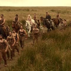 Ser Jorah rides with the Dothraki.