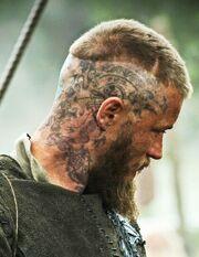 Lucius tattoo
