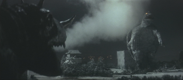 File:Gamera - 2 - vs Barugon - 18 - Barugon smokes Gamera.png