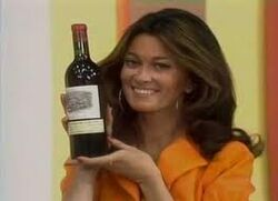 Anitra with Wine Bottle