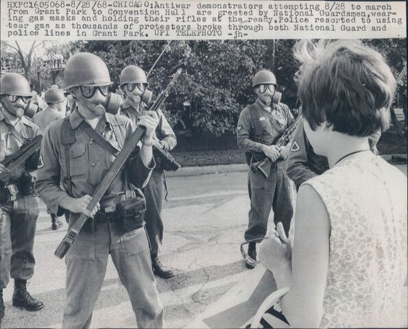 File:Anti-War Protester Faces Off With National Guardsmen Wearing M9A1 Gas Masks.jpg