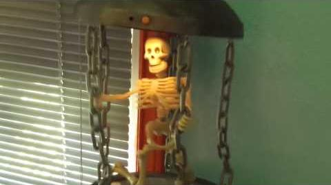 Gemmy caged skeleton animated Halloween prop
