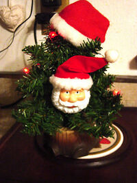 Gemmy animated santa claus in christmas tree 2