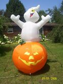 Gemmy inflatable ghost on pumpkin