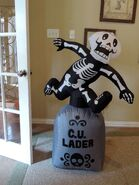 Gemmy inflatable skeleton jumping over tombstone