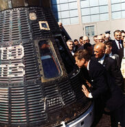 JFK inspects Mercury capsule%, 23 February 1962