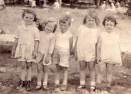 Helen Eloise Freudenberg (1928-1989) is second from left at a church picnic circa 1930