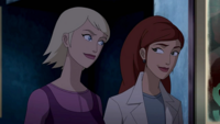 Annie and Claire smile at each other
