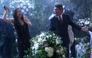 Ep 5x20 - George and Angie in the rain at wedding