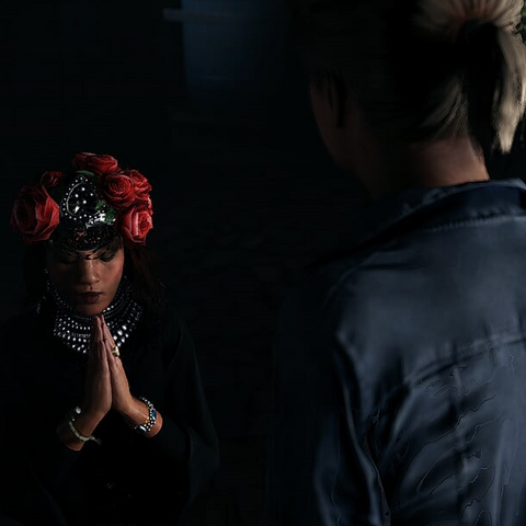 La Santera praying to Sante Muerte after being captured by the Ghosts.