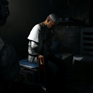 El Cardenal prays after being captured by Nomad and his Ghost team.