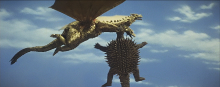 File:SoshingekiAngira Anguirus bites ShodaiGhido King Ghidorah in Destroy All Monsters DAM 2.jpeg
