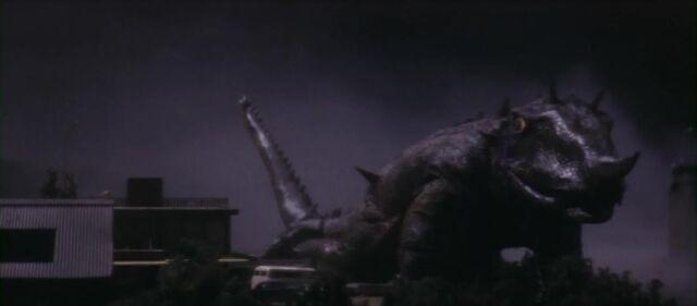File:Barugon breaks the bridge Gamera threw him at.jpg