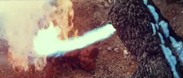 File:All Monsters Attack - MusukoGoji fires atomic breath at Kamacuras number 2 and he dies.png