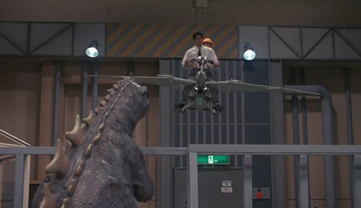 File:Baby Godzilla watching humans fly.jpg