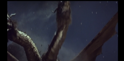 Ouch! Ghidorah is hurt by the rock!