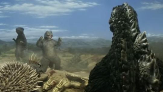 File:Minilla and Gorosaurus cheer whilst Godzilla watches.png