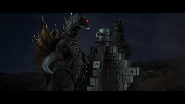 File:Godzilla and Gigan tear through a building a la King Kong vs Godzilla.png