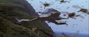 Godzilla vs. Megaguirus - Hundreds of Meganulas fly past the Griffon