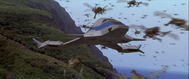 File:Godzilla vs. Megaguirus - Hundreds of Meganulas fly past the Griffon.png