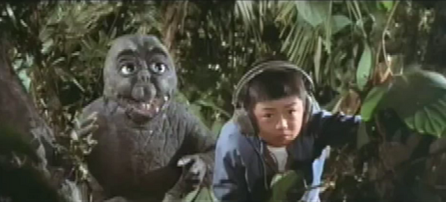 File:All Monsters Attack 3 - Minilla and the kid.png