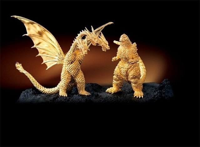 File:Godzilla vs king ghidorah golden sttues.jpg