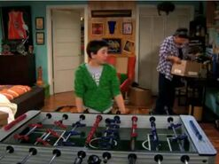 Gabe at foosball table - cropped