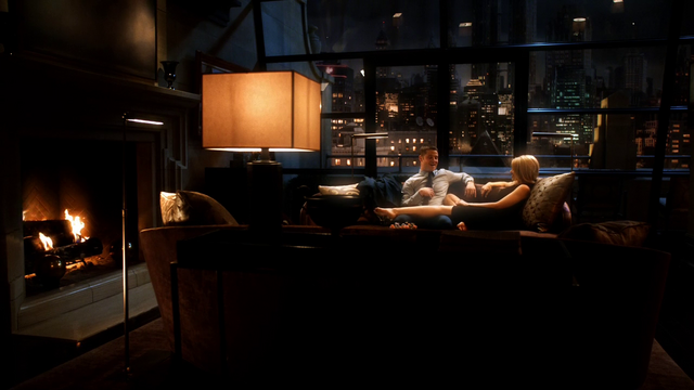 File:Barbara and Jim sitting on the couch in her penthouse.png