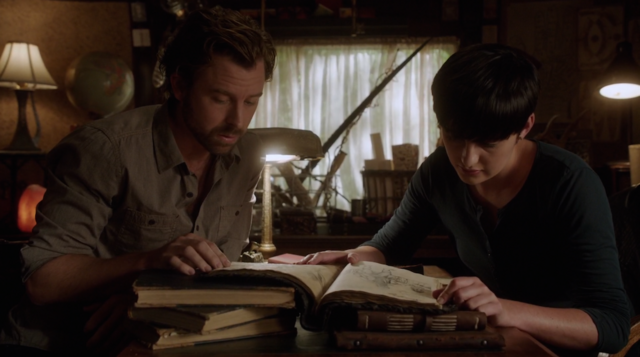 File:407-Josh and Trubel hit the books.png