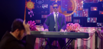 Phil plays the keyboard while a man dances