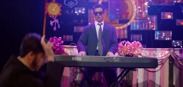 File:Phil plays the keyboard while a man dances.png