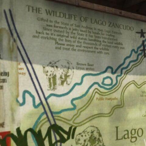 The bear on the Lago Zancudo tourist information board.