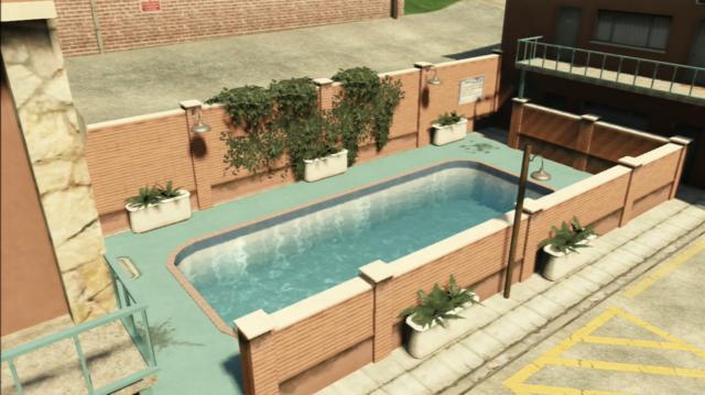 File:ThePinkCageMotel-SwimmingPool-GTAV.PNG