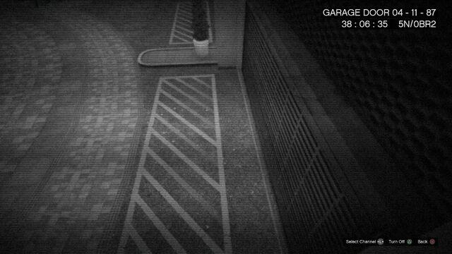 File:CCTV GTAOe GarageDoor.jpg
