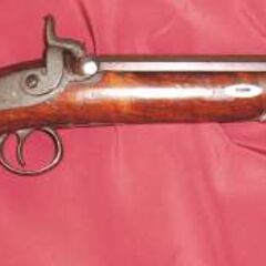 An English percussion pistol.