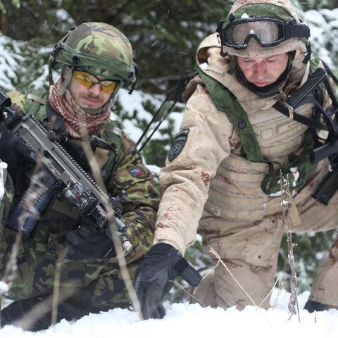 A Czech soldier (left) holding a CZ 805 BREN A2.