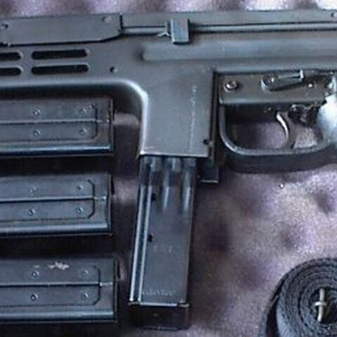 A Spectre, with sling and three spare magazines and no vertical foregrip.