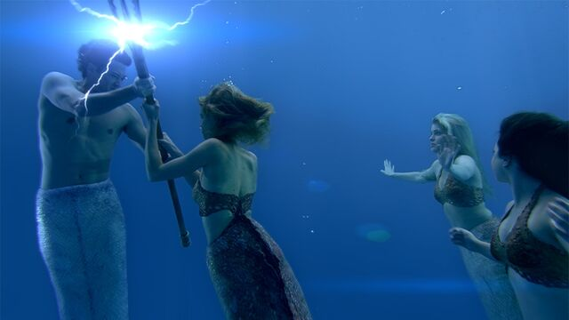File:Lyla trying to take the Trident from Zac.jpg