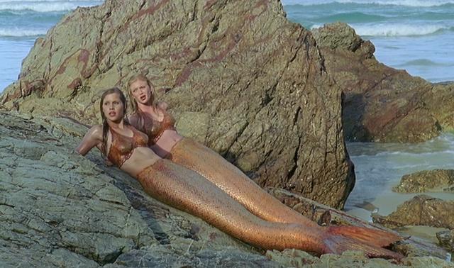 File:Rikki and Emma on Rocks.png