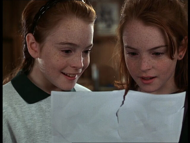 File:Hallie and Annie both look at the torn picture.jpg