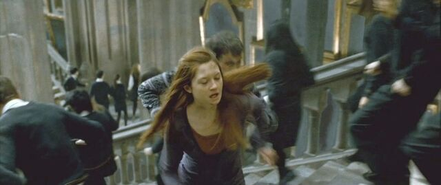 File:DH2 Ginny Weasley and other Hogwarts students running at the Staircase.jpg